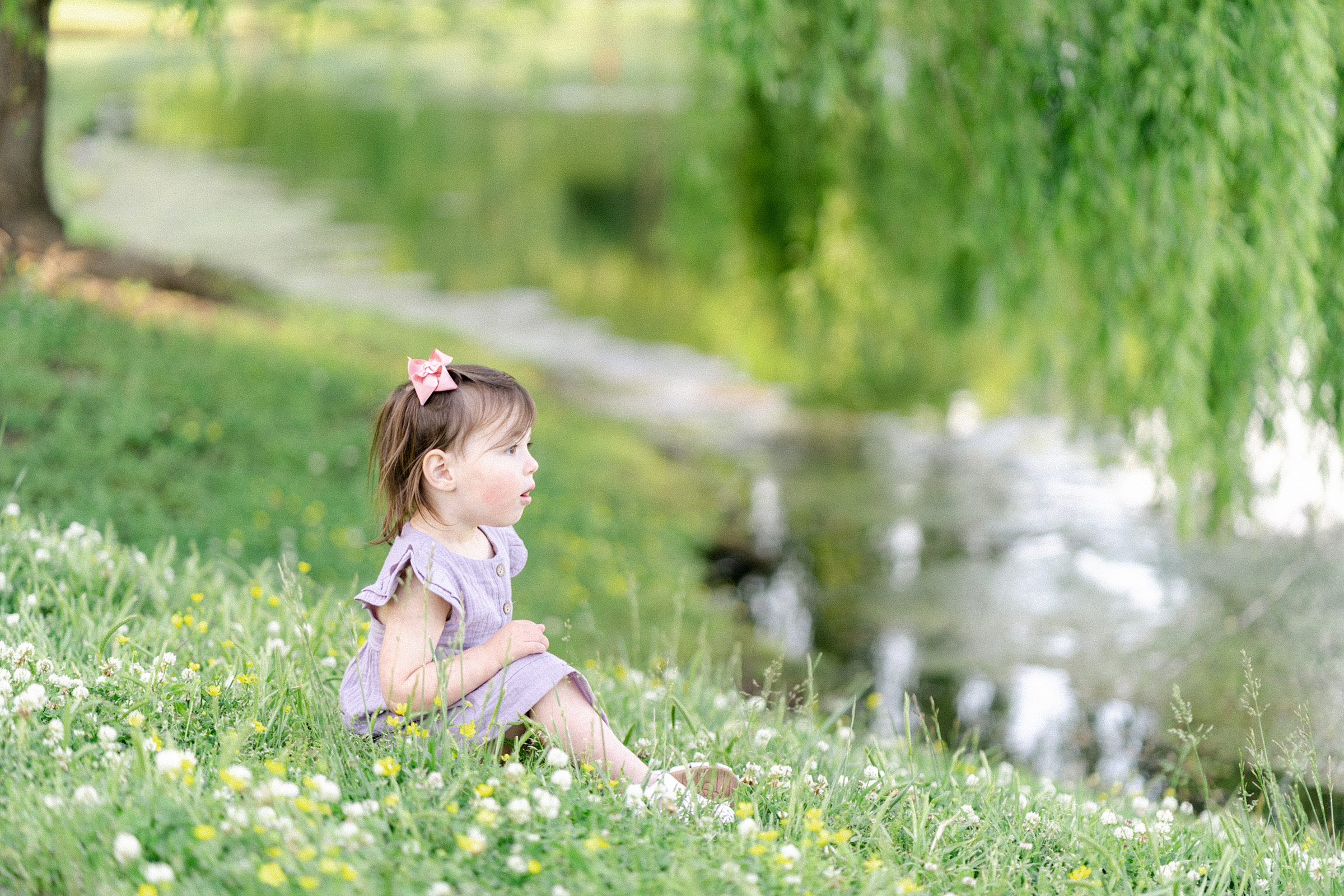 daughter sits by pond during TN family session
